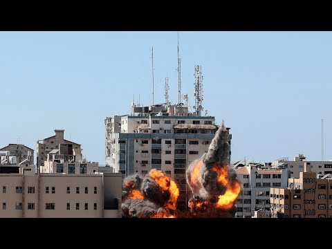 Watch the moment an Israeli air strike hits the Associated Press and Al-Jazeera offices in Gaza
