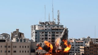 video: Israel destroys Gaza media building as rockets rain on Tel Aviv