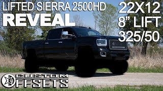 "Custom Sierra 2500HD Reveal! || 22x12's, 8"" Lift and 325/50's!"