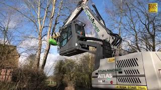 Holzfäller Forstmaschinen im Einsatz - großer Raupenbagger ATLAS 260 - Vermeer - woodcutter at work