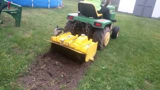 Sold John Deere model 30 tiller on a 318 tractor