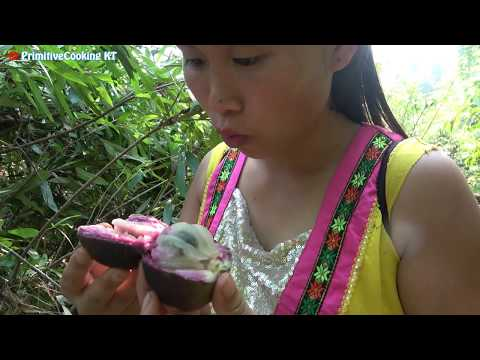Survival skills - Primitive life finding food meet natural fruits - Eating delicious