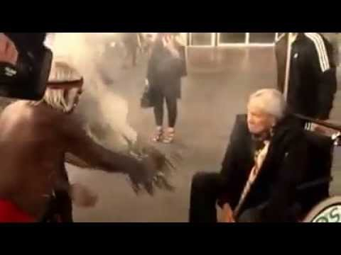 Australian Aboriginal elder greets Native American elder with Smoking Ceremony