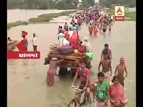 Flood waters flowing across the 81 no National Highway at Malda, ABP Ananda Team Highlight