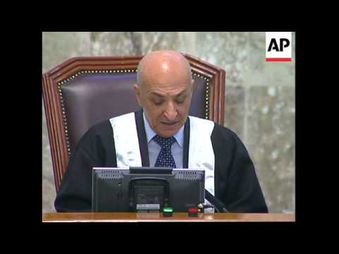 Saddam appears after hospitalisation, rails at Chief Judge