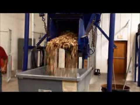 Wood Chips On Jeffrey Rader Brand Electromagnetic Vibratory Feeder