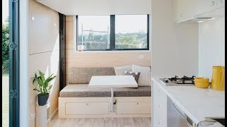 Minimalist Tiny House Is Only 15' Long Retractable Bed