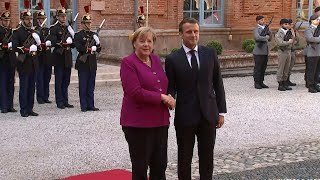 Macron, Merkel in Toulouse for Franco-German council | AFP