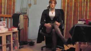 Crossdressing wearing a sexy business suit & seamed nylon stockings
