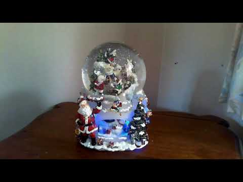 CHRISTMAS MUSICAL WATER GLOBE WITH REVOLVING BASE