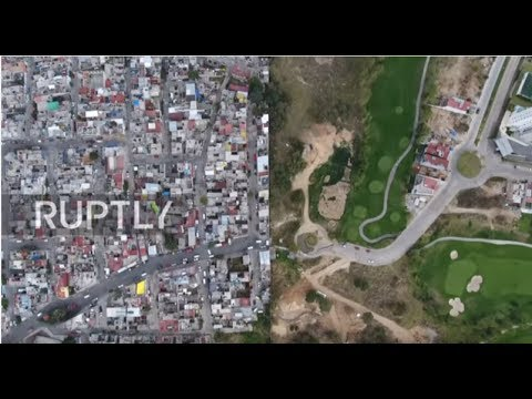 Mexico: Bird-eye view of wall dividing deprived neighbourhood from luxury golf course