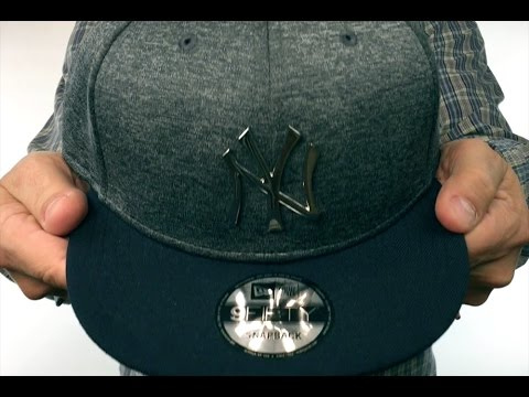 c0eb3c95886e4 Yankees  SILVER METAL-BADGE SNAPBACK  Shadow Tech-Navy Hat by New ...