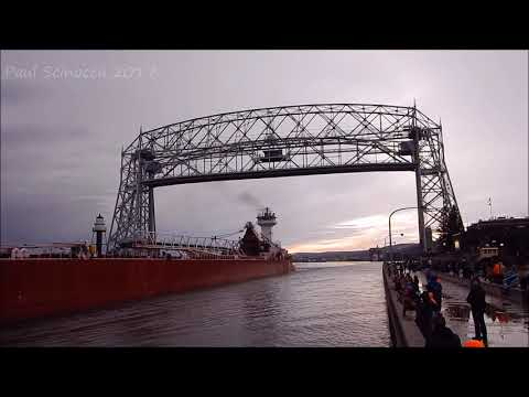 Great Lakes Trader departing with a Captain's salute and full of ore.