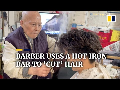 This Chinese barber uses a hot iron bar to 'cut' hair