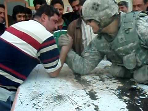 Army soldier embarrasses Iraqi in armwrestling