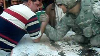 Army soldier embarrasses Iraqi in arm-wrestling