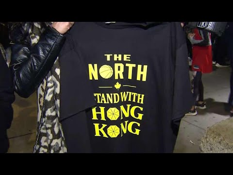 Pro-Hong Kong protesters hand out t-shirts at Raptors game