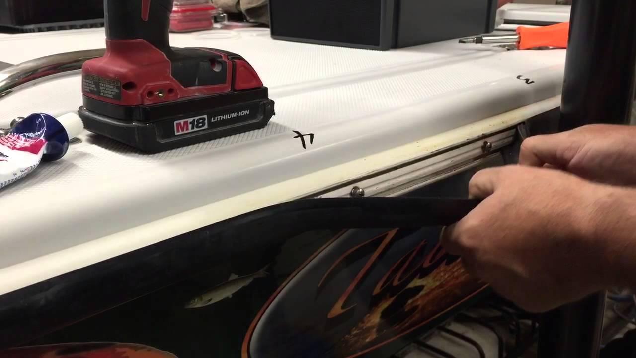 How to Tighten the Screws Under a Rub Rail