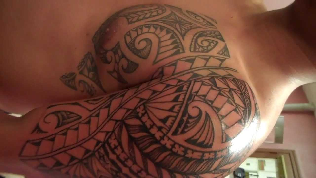 Landos Poly Tribal Style Freehand Island Chest And Arm Tattoo