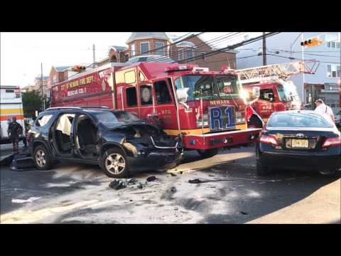 FOOTAGE OF NEWARK FIRE DEPARTMENT RESCUE SQUAD 1 INVOLVED IN MULTIPLE VEHICLE MVA IN NEWARK, NJ.