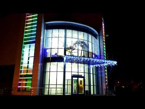 Архитектурная управляемая подсветка торгового центра. Компания  «Современные системы и технологии»
