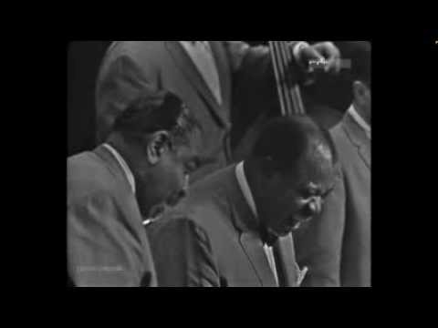 "louis armstrong at berlin 1965 ""satchmo in east berlin - march 22, 1965"" is a live concert video in which louis armstrong and his all-stars perform over 20 songs louis armstrong and his all-stars is made up of lead musician armstrong and five other musicians as well as one vocalist who appears on stage multiple times."
