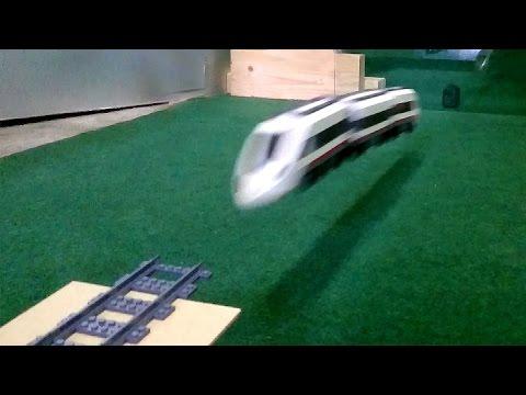 Lego train crashing onto glass