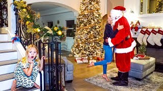 Everleigh Catches Her Mommy Kissing Santa Claus...