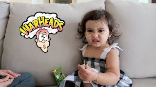 baby vs extreme sour warhead hilarious reaction