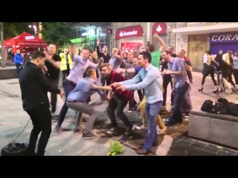 Gang of lads join in with Liverpool street singer