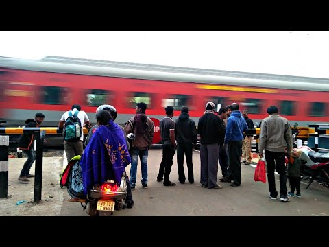 Railroad public Amazed Seeing Speed Of The Rajdhani Express At The Railway gate
