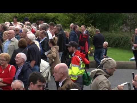 The people of Derry give Bishop Edward Daly an emotional farewell
