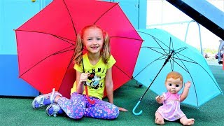Having Fun with baby dolls & Colored Umbrellas