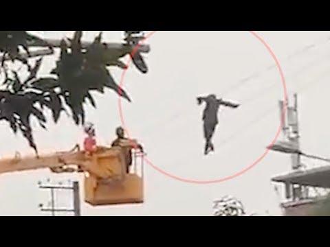 Chinese Tarzan: Drunk Man Walks On High Power Voltage Lines