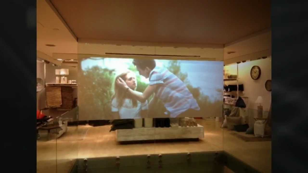 rear projection film Glassmovie is a rear projection film to animate shop windows the movie-style pictures are projected from behind the glass surface, enabling them to be viewed by those passing by outside for added impact.