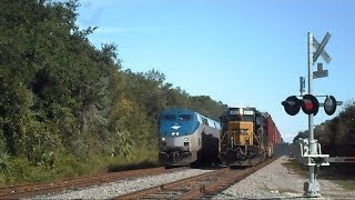 Amtrak Train Silver Star Passes CSX Train Making Pick Ups