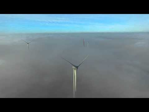 Wind Turbines above the Fog