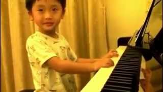 Repeat youtube video 4 Year Old Boy Plays Piano Better Than Any Master