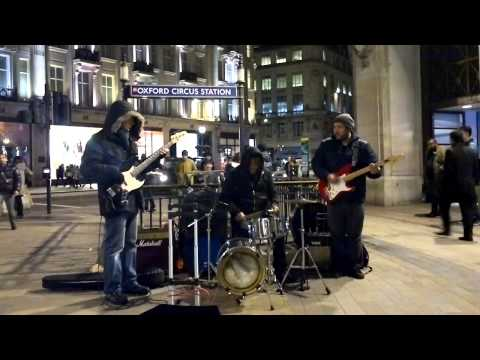 Band playing in front of Oxford Circus Station, London