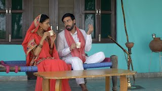 Indian village couple relaxing and having tea together - leisure concept. Rural ancestral home