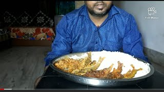 Spicy tengra fish and rice eating