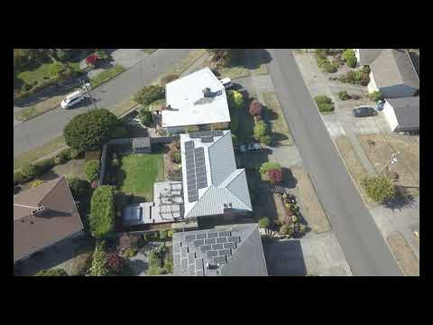 Metal Roof  & Solar Project in Seattle by Pinnacle Roofing Professionals, LLC
