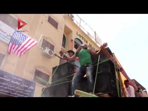 رقص شعبي وعلم أمريكا في مولد أبو الحجاج بالأقصر