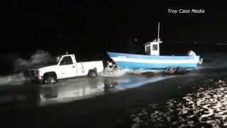 Truck gets stuck in the Pacific Ocean with the boat on the trailer