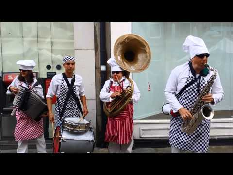 Some crazy chefs with brass instruments playing Johnny Cash...