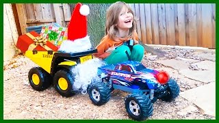 Dump Truck O'Claus and Rednosed Monster Truck Deliver Christmas Presents