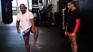 How to Check Leg Kicks in Kickboxing | Muay Thai