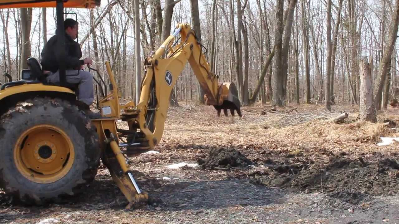 First Time Using Backhoe To Dig Out Tree Stump