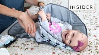 Changing Pad Keeps Baby's Hands Away From Dirty Diaper thumbnail