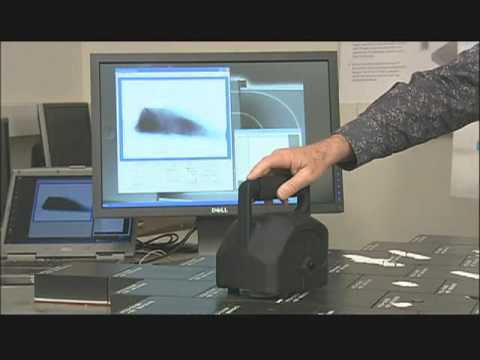 High-Speed Three-Dimensional Laser Scanner with Real-Time Processing